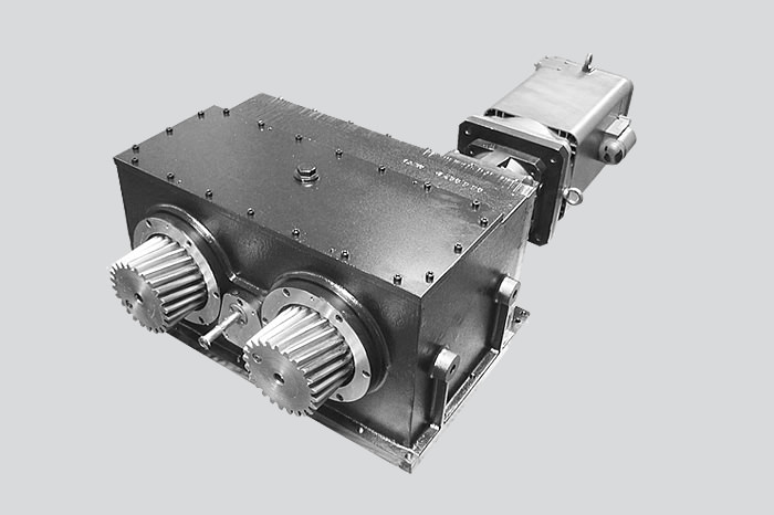 Low backlash rack-and-pinion feed drive